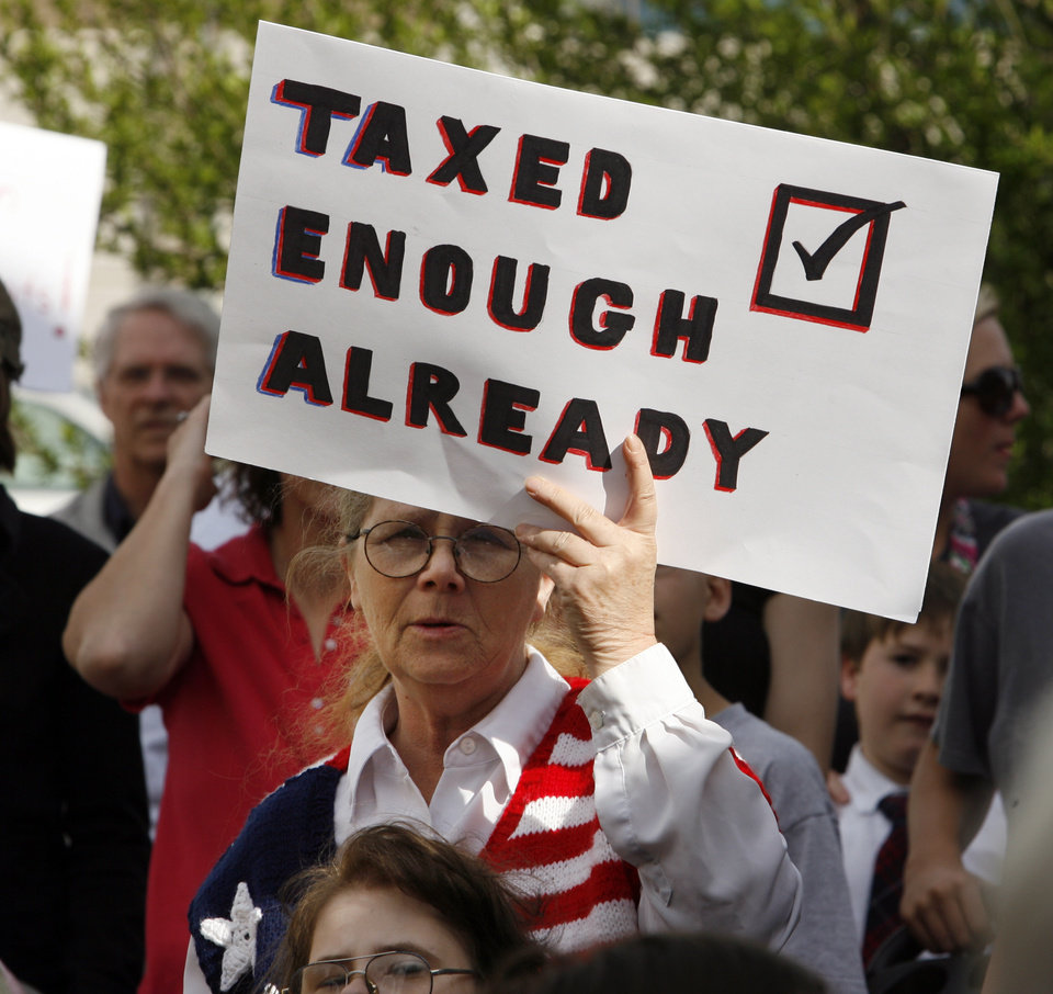 Photo - Citizens hold a Tax Day Tea Party at the Santa Fe Station in Norman, Okla. on Wednesday, April 15, 2009.  