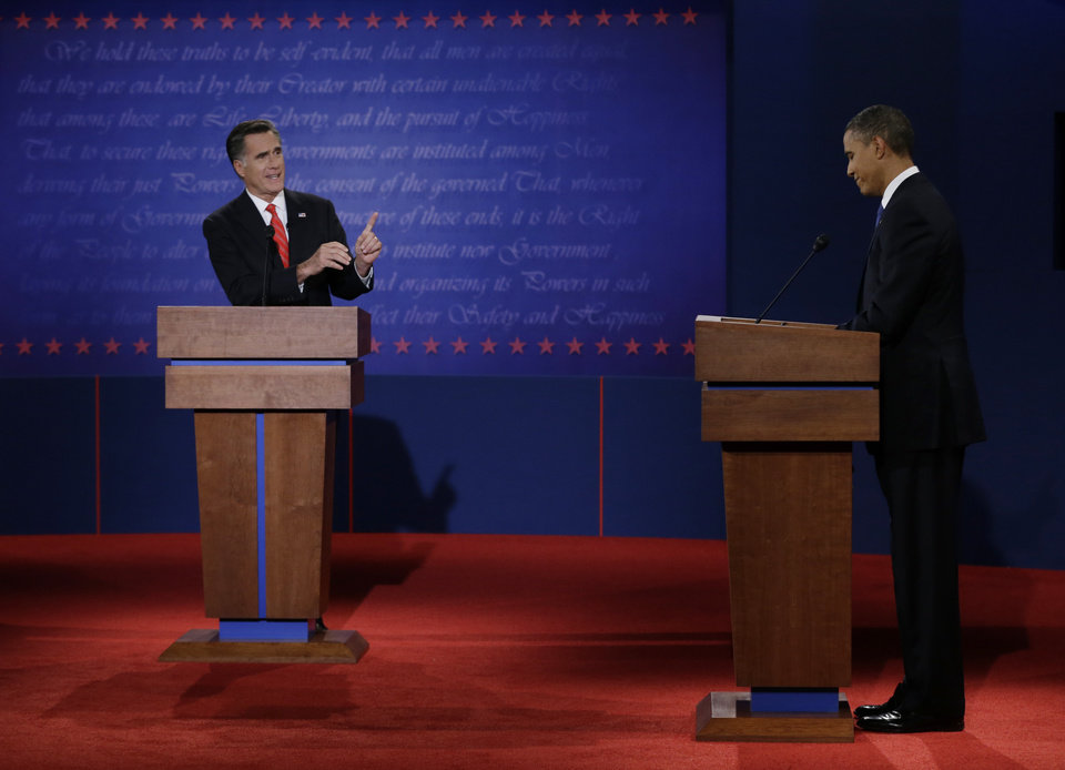Photo -   FILE - In this Oct. 3, 2012 file photo, Republican presidential nominee Mitt Romney points to President Barack Obama during the first presidential debate at the University of Denver in Denver. Romney turned in a commanding performance in the first debate, while Obama was lackluster and disengaged. The contrast was startling, and it reinvigorated the Republican candidate and his supporters.