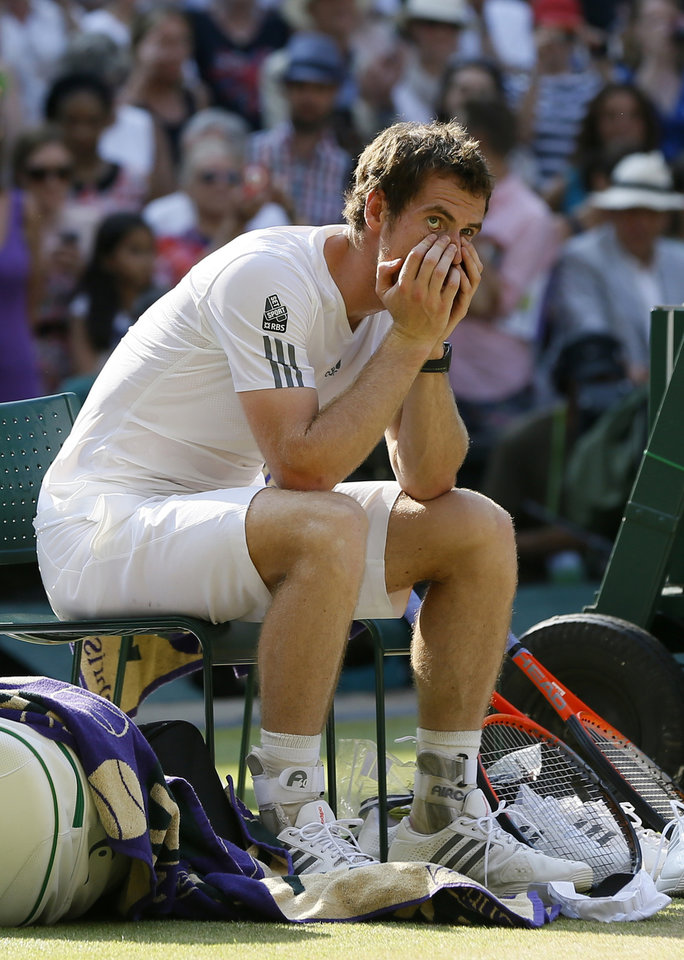 Photo - Andy Murray of Britain reacts before the trophy presentation after defeating Novak Djokovic of Serbia during the Men's singles final match at the All England Lawn Tennis Championships in Wimbledon, London, Sunday, July 7, 2013. (AP Photo/Kirsty Wigglesworth)