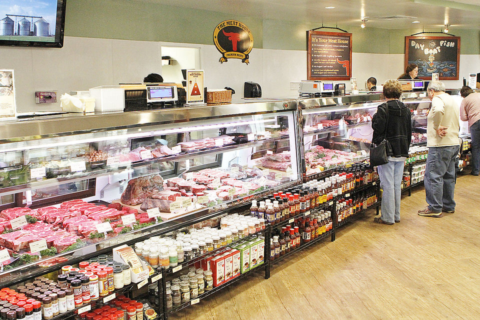 Photo - Customers look at meats and other grocery items at The Meat House in Edmond not long after it opened in November. The Meat House plans several other locations in the Oklahoma City area.Photo by David McDaniel, The Oklahoman Archives
