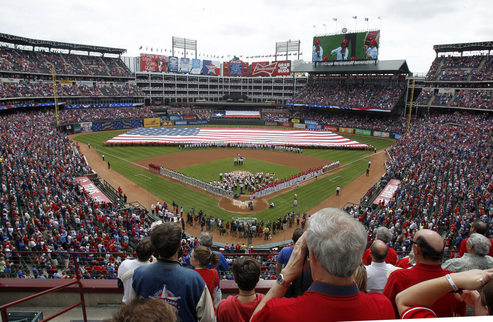 Photo - The Fort Worth Symphony Orchestra performs at Globe Life Park before an opening day baseball game between the Texas Rangers and the Philadelphia Phillies, Monday, March 31, 2014, in Arlington, Texas.  (AP Photo/Kim Johnson Flodin)