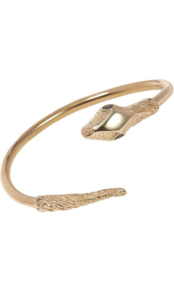 Photo - For those who follow the Chinese zodiac, the year of the snake begins Feb. 10. Some ways to incorporate the symbol of the year into your wardrobe, with no harm done to any living creature include this Jennifer Fisher brass snake cuff, $315 from Barneys.com. (Barneys.com via Los Angeles Times/MCT)