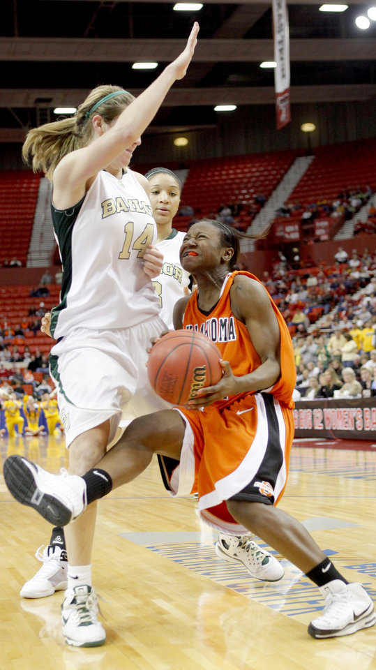 Photo - OSU's Andrea Riley runs into Baylor's Rachel Allison as Jessica Morrow watches during the Big 12 Women's Championship game between Oklahoma State and Baylor at the Cox Center in Oklahoma City, Friday, March 13, 2009.  PHOTO BY BRYAN TERRY, THE OKLAHOMAN