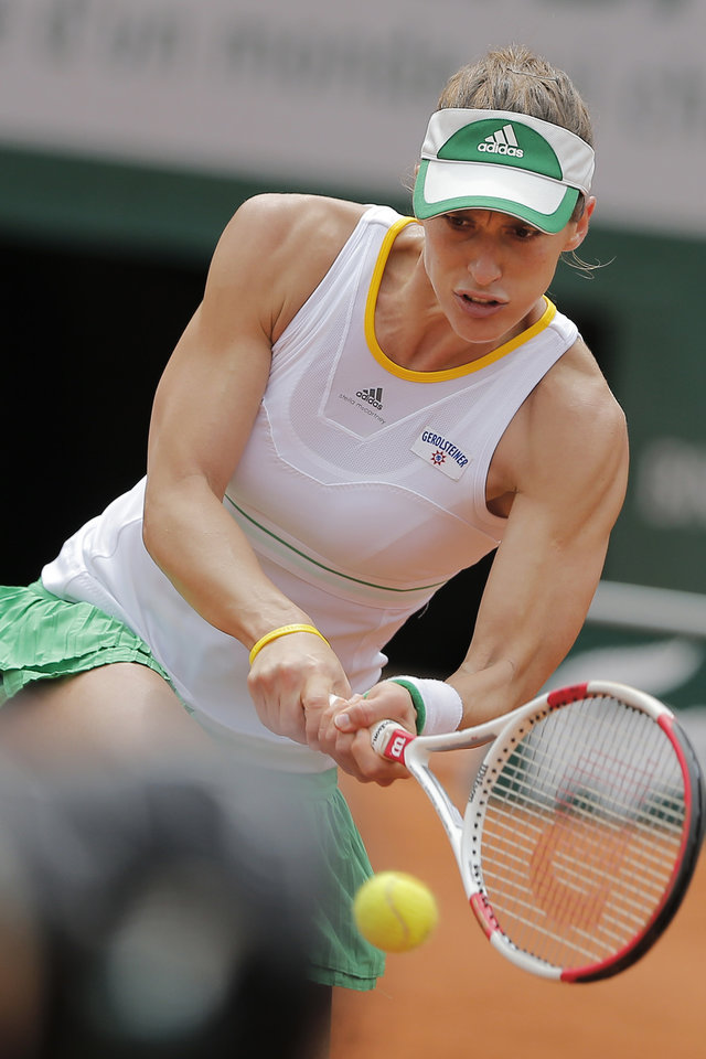 Photo - Germany's Andrea Petkovic returns the ball during the fourth round match of the French Open tennis tournament against Netherlands' Kiki Bertens at the Roland Garros stadium, in Paris, France, Monday, June 2, 2014. Petkovic won in three sets 1-6, 6-2, 7-5. (AP Photo/Michel Spingler)