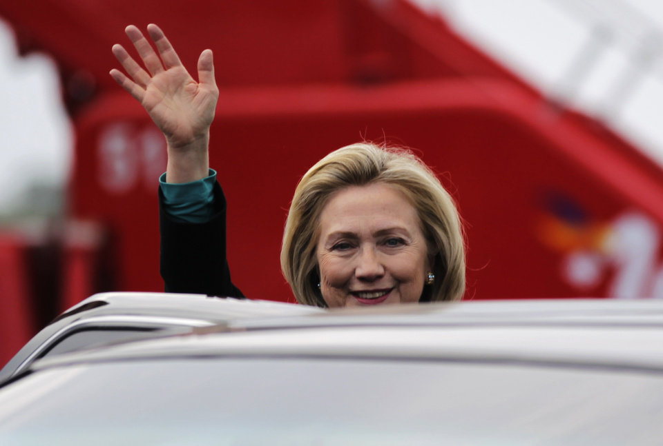 U.S. Secretary of State Hillary Clinton waves as she arrives at the airport in Cartagena, Colombia Friday April 13, 2012. Leaders of the western hemisphere will attend the 6th Summit of the Americas in Cartagena this weekend. (AP Photo/John Vizcaino, Pool)