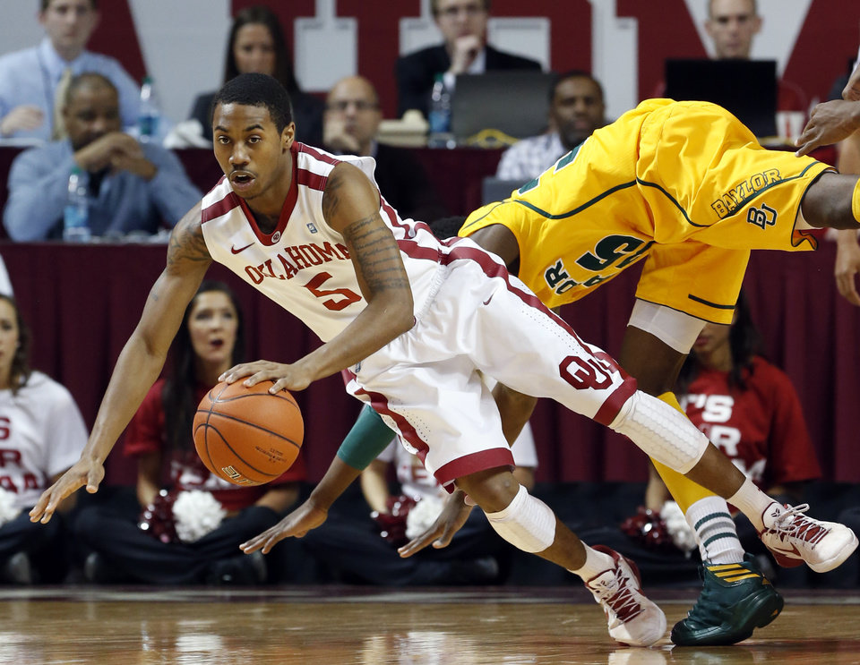 Photo - Oklahoma Sooner's Je'lon Hornbeak (5) is folded by Baylor Bear's Taurean Prince (35) going for loose ball as the University of Oklahoma Sooners (OU) men play the Baylor University Bears (BU) in NCAA, college basketball at The Lloyd Noble Center on Saturday, Feb. 23, 2013  in Norman, Okla. Photo by Steve Sisney, The Oklahoman