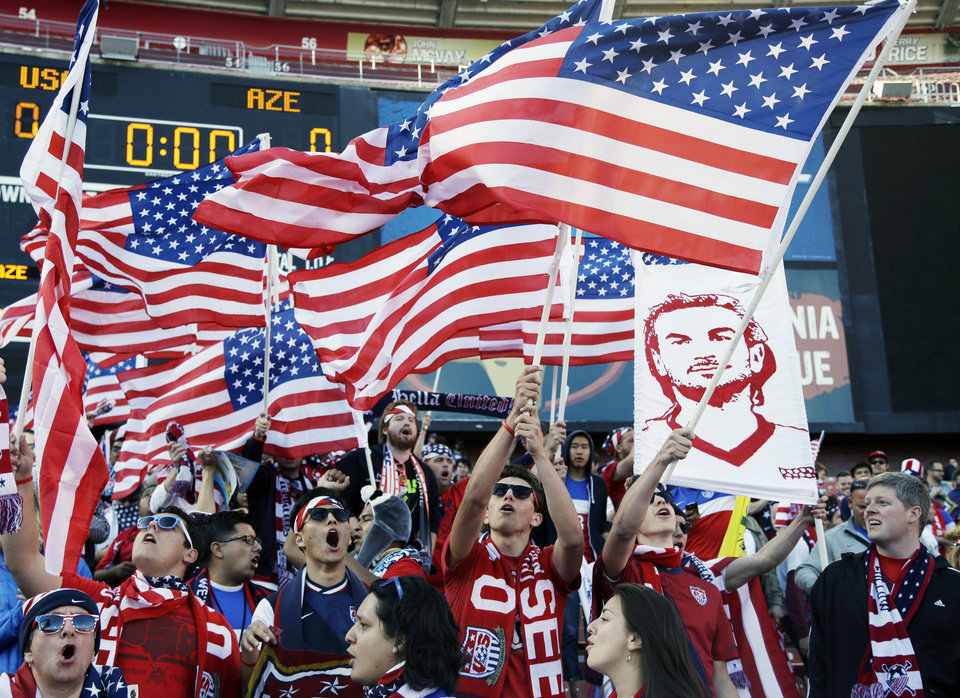 Photo - Fans wave American flags before the start of an international friendly soccer match between the United States and Azerbaijan on Tuesday, May 27, 2014, in San Francisco. (AP Photo/Marcio Jose Sanchez)