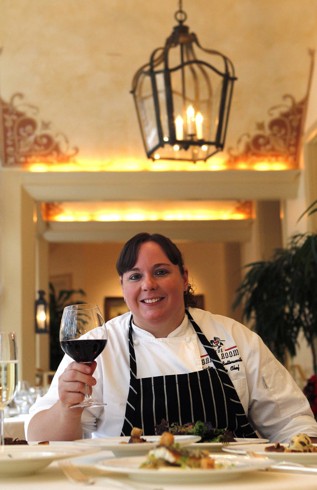 Photo - In this Dec. 7, 2012 photo, executive chef Kristin Butterworth poses for a photograph with her reveillon menu at the Grill Room of the Windsor Court Hotel in New Orleans. Roughly 50 restaurants in New Orleans are reviving an old Creole custom called reveillon, which stems from the old French tradition of eating a lavish meal after midnight Mass on Christmas Eve. (AP Photo/Gerald Herbert)