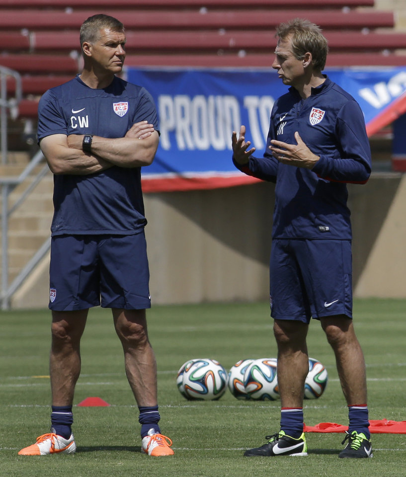 Photo - United States soccer coach Jürgen Klinsmann, right, speaks with goalie coach Chris Woods during training in preparation for the World Cup soccer tournament on Thursday, May 22, 2014, in Stanford, Calif. (AP Photo/Ben Margot)