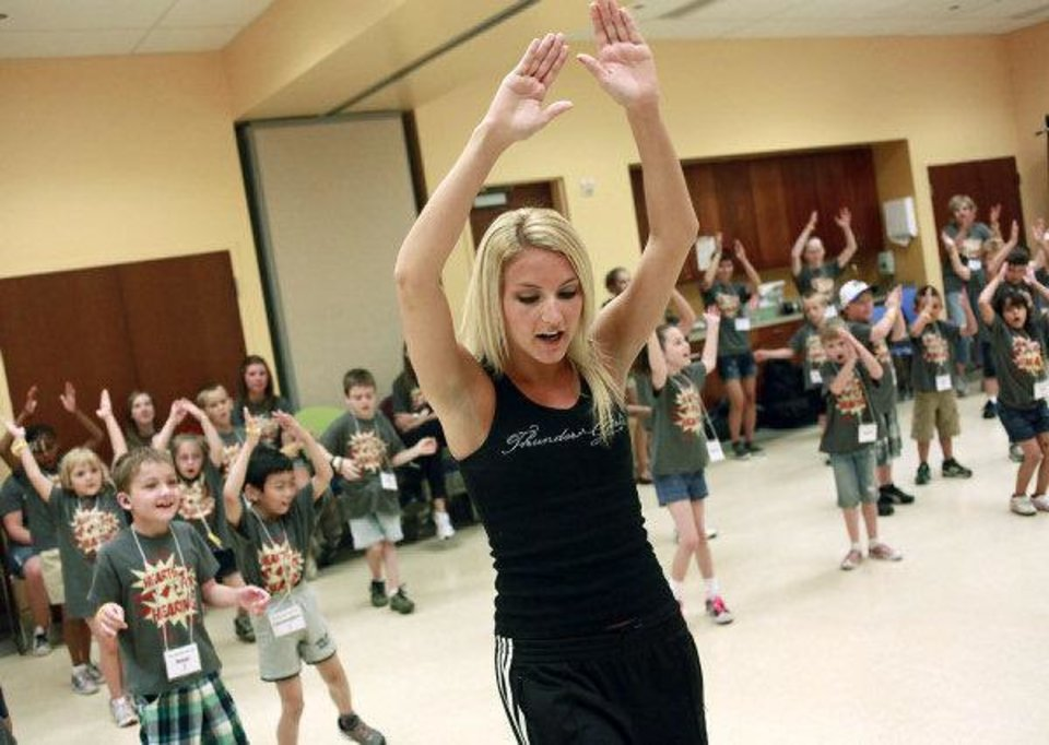 Photo - Sheri, a Thunder Girl, teaches children a dance routine at the Oklahoma City Museum of Art. The dance class was one of many activities of the weeklong Hearts for Hearing summer camp in downtown Oklahoma City this week. Photo by John Clanton, The Oklahoman  JOHN CLANTON