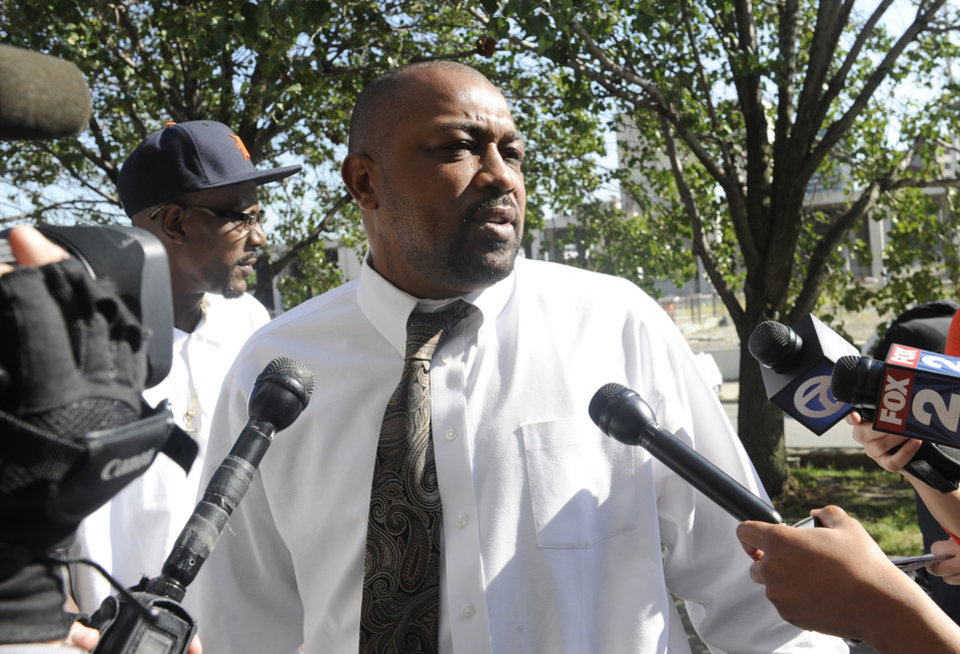Photo - Walter Simmons, father of Renisha McBride, speaks to reporters outside the courthouse before the sentencing hearing of Theodore Wafer, Wednesday, Sept. 3, 2014, 2014, in Detroit. Wafer was sentenced to at least 17 years in prison on Tuesday for killing an unarmed Renisha McBride on his porch. During the trial, he said he shot the 19-year-old because he feared for his life, but a jury rejected Wafer's claim of self-defense. (AP Photo/Detroit News, Clarence Tabb Jr.)  DETROIT FREE PRESS OUT; HUFFINGTON POST OUT, MANDATORY CREDIT