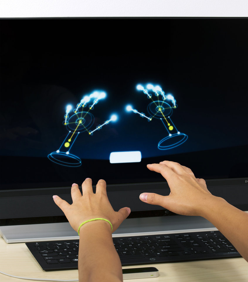 Photo - This project image released by Leap Motion shows the Leap Motion Controller that went on sale earlier this year. Motion-detecting and touch-sensitive controllers were among the topics discussed at the Game Developers Conference Next at the Los Angeles Convention Center on Nov. 5-7, 2013. (AP Photo/Leap Motion)