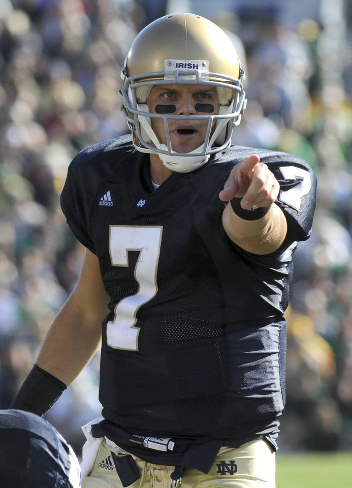 Photo - ** FILE ** In this Sept. 27, 2008 file photo, Notre Dame quarterback Jimmy Clausen points from the line of scrimmage during NCAA college football action against Purdue in South Bend, Ind. (AP Photo/Joe Raymond, File) ORG XMIT: NY180