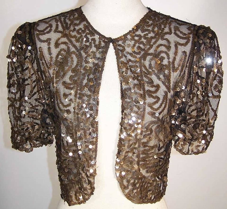 A sequined or beaded jacket will create a new look when layerd over a little black dress. Photo provided. <strong></strong>