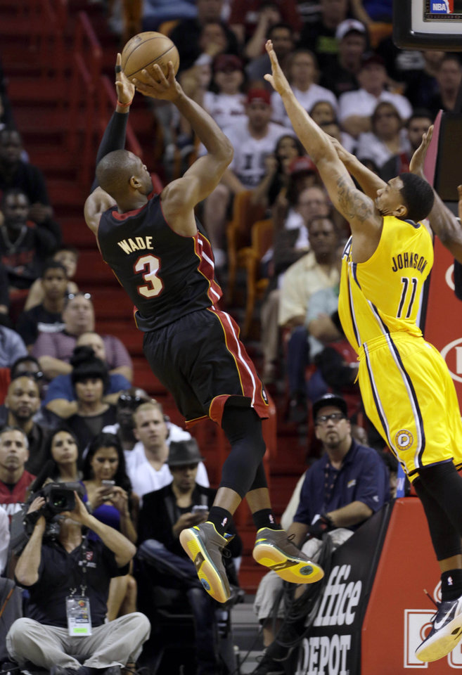 Photo - Miami Heat's Dwyane Wade (3) prepares to shoot over Indiana Pacers' Orlando Johnson (11) during the first half of an NBA basketball game in Miami, Sunday, March 10, 2013. (AP Photo/Alan Diaz)