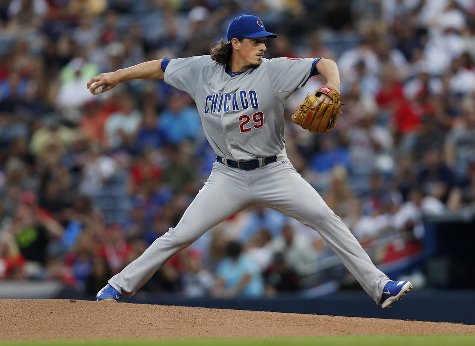 Photo - Chicago Cubs starting pitcher Jeff Samardzija (29) works in the first inning of a baseball game against the Atlanta Braves, Saturday, May 10, 2014, in Atlanta.  (AP Photo/John Bazemore)