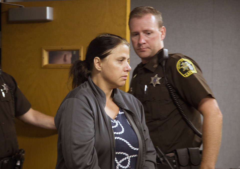 Photo - Valbona Lucaj, 44, of Metamora Township, Mich. appears in District Court in Lapeer, Mich., Friday, Aug. 1, 2014. Bond has been set at $500,000 for a Lucaj and her husband, Sebastiano Quagliata, who are charged with second-degree murder after their dogs fatally mauled a 46-year-old jogger on a rural Michigan road on July 23. (AP Photo/Detroit Free Press, Kathleen Galligan)  DETROIT NEWS OUT;  NO SALES