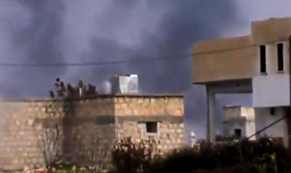 In this image taken from video obtained from the Shaam News Network, which has been authenticated based on its contents and other AP reporting, smoke rises from buildings in Taftanaz village, Idlib province, northern Syria, on Wednesday, Jan. 2, 2013. Rebels attacked a sprawling air base on Wednesday as the opposition expanded its offensive on military airports in an attempt to sideline a major weapon in the hands of President Bashar Assad�s forces. The Observatory said the rebel assault on the Taftanaz base was preceded by heavy shelling of the area, and the fighters appeared to be trying to storm the facility. (AP Photo/Shaam News Network via AP video)