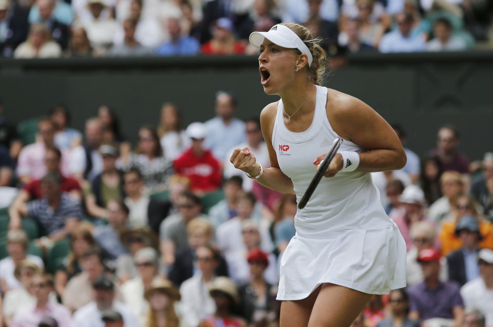 Photo - Angelique Kerber of Germany celebrates winning a point against Maria Sharapova of Russia during their women's singles match at the All England Lawn Tennis Championships in Wimbledon, London, Tuesday, July 1, 2014. (AP Photo/Ben Curtis)