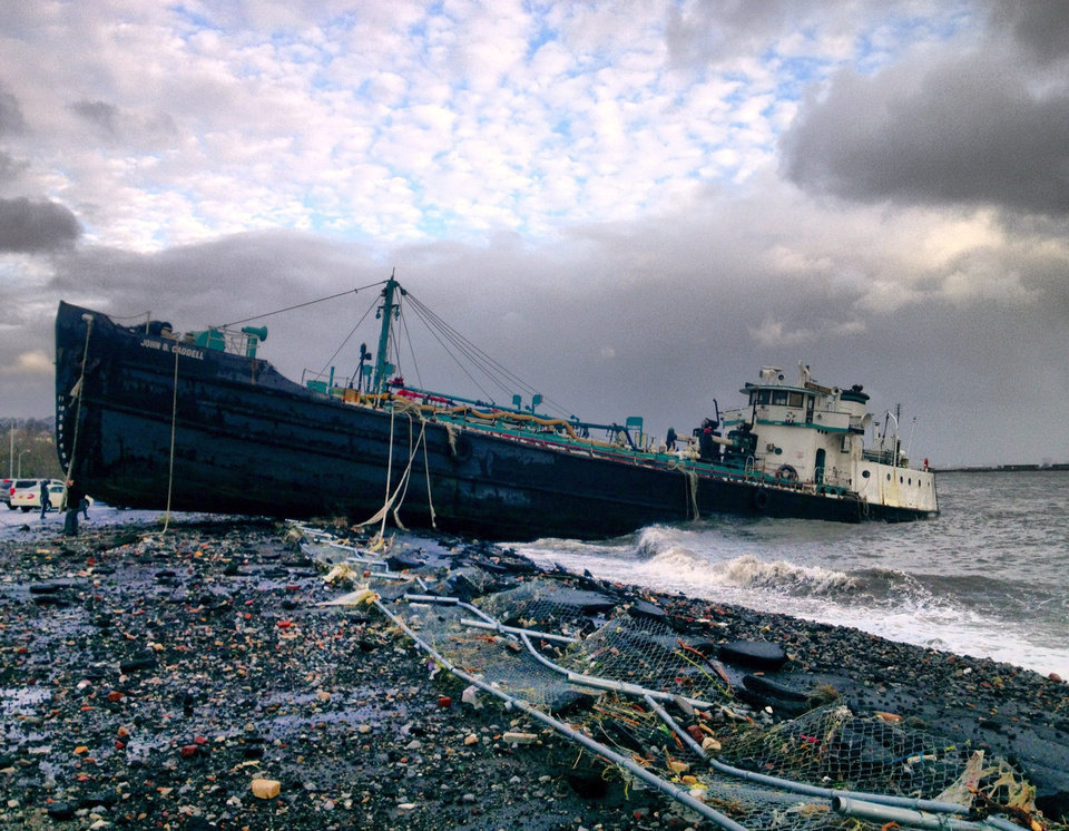 A 168-foot water tanker, the John B. Caddell, sits on the shore Tuesday morning, Oct. 30, 2012 where it ran aground on Front Street in the Stapleton neighborhood of New York's Staten Island as a result of superstorm Sandy. (AP Photo/Sean Sweeney)  ORG XMIT: NYR101