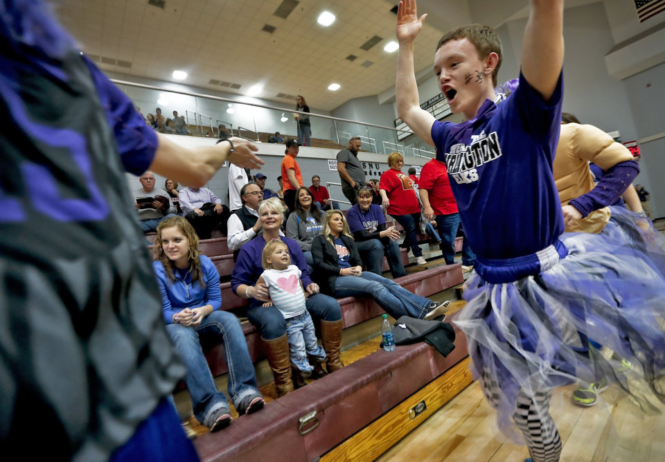 Photo - Burlington fan Reno Talbott runs through the stands as he tries to motivate the crowd during the Class B girls state basketball quarterfinal game between Okarche and Burlington at Southern Nazarene University in Bethany, Okla. on Thursday, March 6, 2014.  Photo by Chris Landsberger, The Oklahoman
