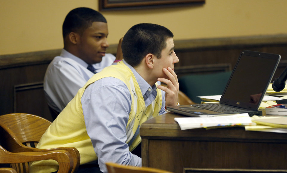 Photo - Trent Mays, 17, left, and co-defendant 16-year-old Ma'lik Richmond sit at the defense table during a recess of their trial on rape charges in juvenile court on Thursday, March 14, 2013, in Steubenville, Ohio. Mays and Richmond are accused of raping a 16-year-old West Virginia girl in August of 2012. (AP Photo/Keith Srakocic, Pool)