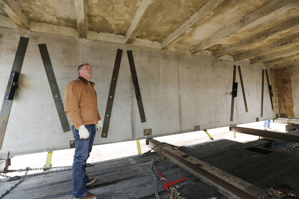 Photo - Homebuilder Jay London inspects a monolithic safe space for a tornado-resistant house he's building in Moore.  Steve Gooch - The Oklahoman