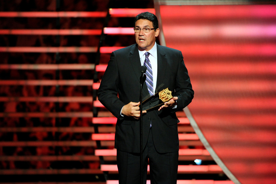Photo - Carolina Panthers coach Ron Rivera accepts the Coach of the Year Award at the third annual NFL Honors at Radio City Music Hall on Saturday, Feb. 1, 2014, in New York. (Photo by Evan Agostini/Invision for NFL/AP Images)