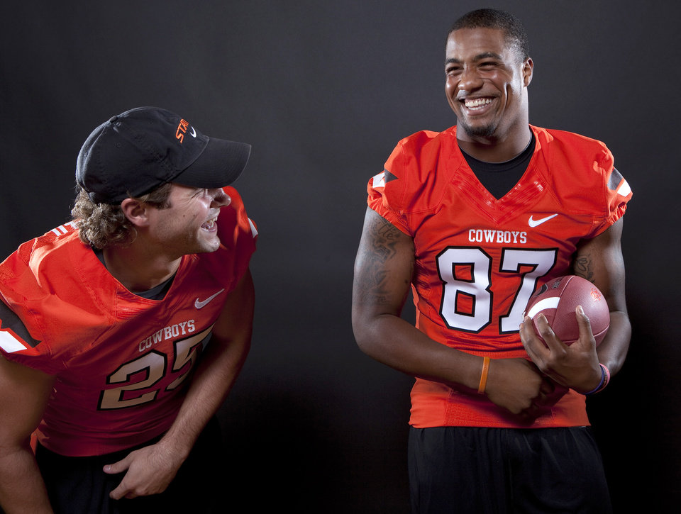 Photo - Oklahoma State's Josh Cooper (25) and Tracy Moore (87) pose for a photo during Oklahoma State's Football media day at  in Stillwater, Okla., Saturday, Aug. 6, 2011. Photo by Sarah Phipps, The Oklahoman
