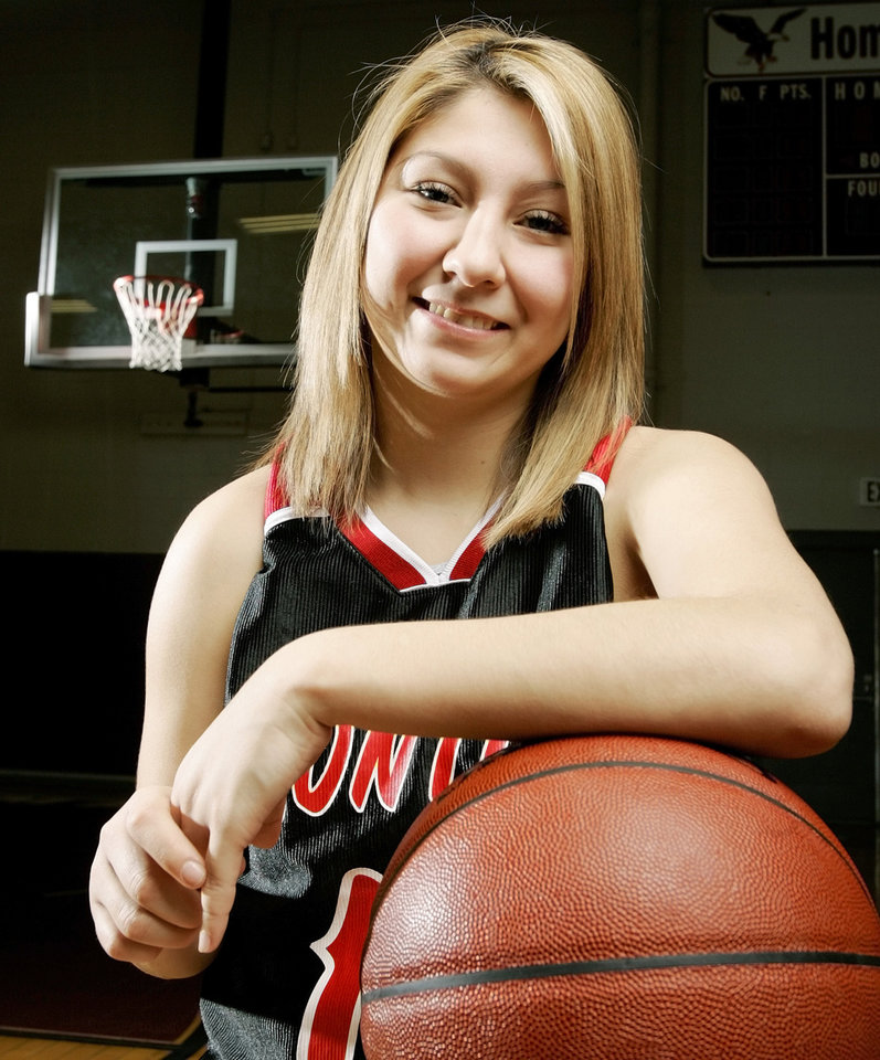 Photo - GIRLS HIGH SCHOOL BASKETBALL: Jenna Plumley of Frontier poses for a photo for the Super Five / All-State basketball section at Oklahoma Christian University in Edmond, Okla., March 30, 2006. By Nate Billings, The Oklahoman.