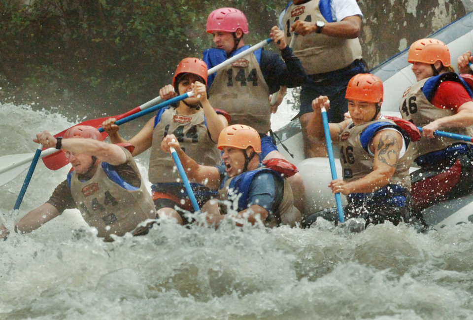 Photo - FILE - This Friday Oct. 6, 2006, file photo, shows members of the military race down the Gauley River during the sixth annual Wilderness Challenge adventure race in Summersville, W.Va.  West Virginia whitewater industry official blames chemical spill in part for drop in bookings. (AP Photo/Jeff Gentner)