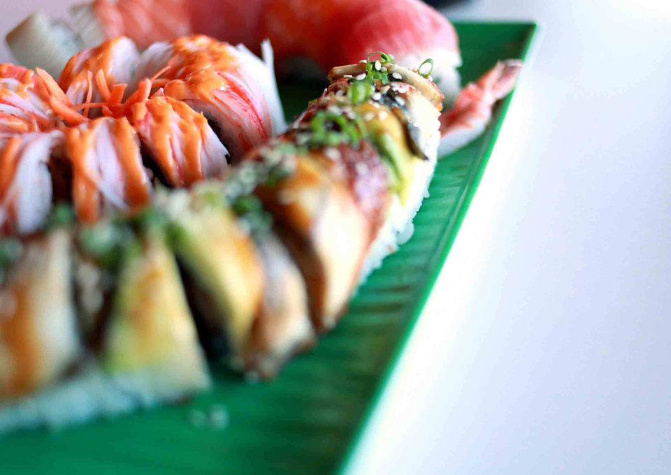 Photo - A Thunder roll (center) Green Dragon roll (foreground) and a Rainbow Roll (background) pose at Sushi Nhinja in north Oklahoma City on Tuesday, Jan. 4, 2011. Photo by John Clanton, The Oklahoman
