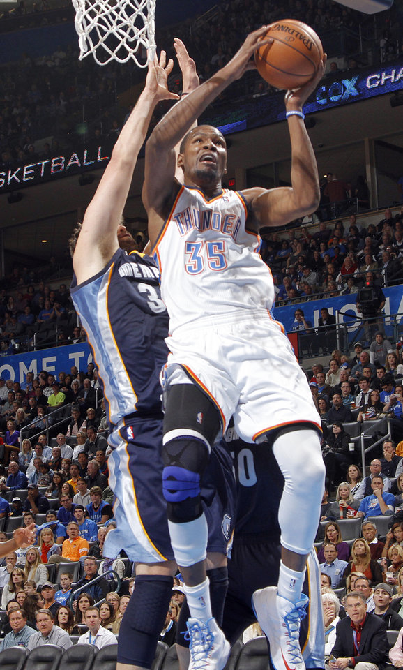 Photo - Oklahoma City's Kevin Durant (35) shoots the ball over Memphis' Marc Gasol (33) during the NBA basketball game between the Oklahoma City Thunder and the Memphis Grizzlies at Chesapeake Energy Arena on Wednesday, Nov. 14, 2012, in Oklahoma City, Okla.   Photo by Chris Landsberger, The Oklahoman