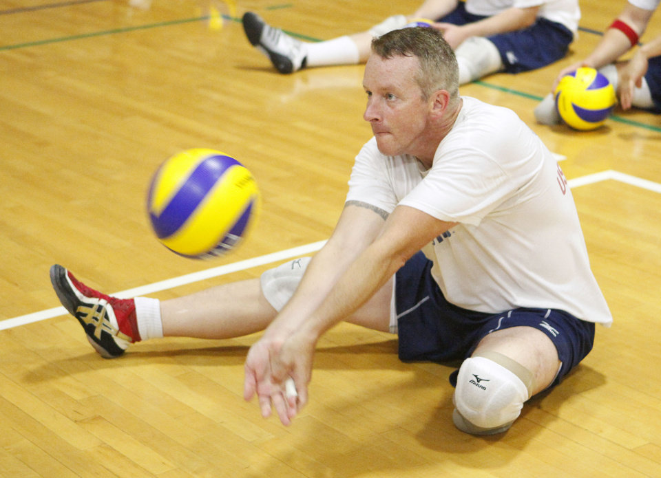 U.S. Army Master Sgt. Ed O'Neil makes a return during sitting volleyball practice at UCO in July. O'Neil will be one of the court coaches for the training camp for the 2011 Warrior Games at UCO in January.  PHOTO BY PAUL HELLSTERN, THE OKLAHOMAN ARCHIVE