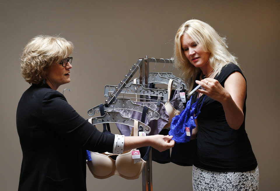 Photo - In this July 31 2014 photo, Carrie Charlick, CEO Essential Bodywear, left, and president Marcia Cubitt talk about product in Commerce Township, Mich. Charlick and Cubitt have $4 million in sales but have been rejected for $500,000 credit lines since 2012.  (AP Photo/Paul Sancya)