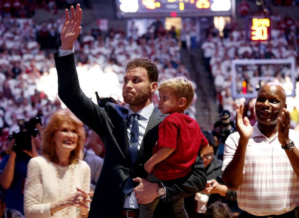 Photo -  Blake Griffin holds son Ford, 2, during a ceremony retiring his jersey at the University of Oklahoma's Lloyd Noble Center on March 1, 2016 in Norman. Does the shakeup of the Los Angeles Clippers create a path to Oklahoma City for Griffin?   [Photo by Steve Sisney, The Oklahoman]