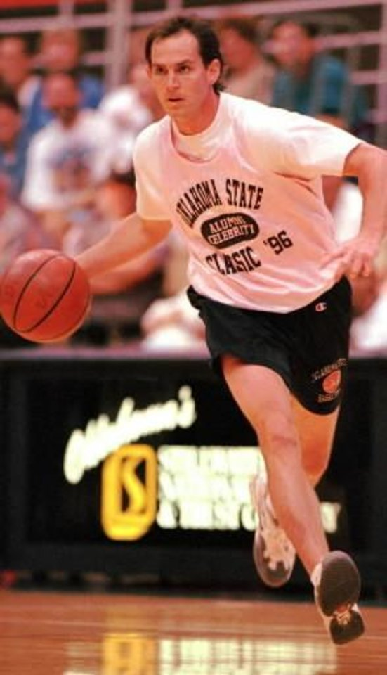 Former OSU player  Sean Sutton moves the ball down court in the second annual celebrity basketball classic in Stillwater in this 1996 photo.
