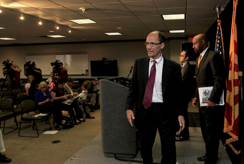 Photo -   United States Assistant Attorney General Thomas Perez, left, who heads up the civil rights division at the Department of Justice, is joined by Deputy Assistant Attorney General for Civil Rights, Roy Austin, right, and Sergio Perez, attorney for the Civil Right Division at the Department of Justice, after Perez announces a federal civil lawsuit against Maricopa County Sheriff Joe Arpaio, his office, and the county, at the conclusion of a news conference Thursday, May 10, 2012, in Phoenix. After months of negotiations failed to yield an agreement to settle allegations that his department racially profiled Latinos in his trademark immigration patrols. (AP Photo/Ross D. Franklin)