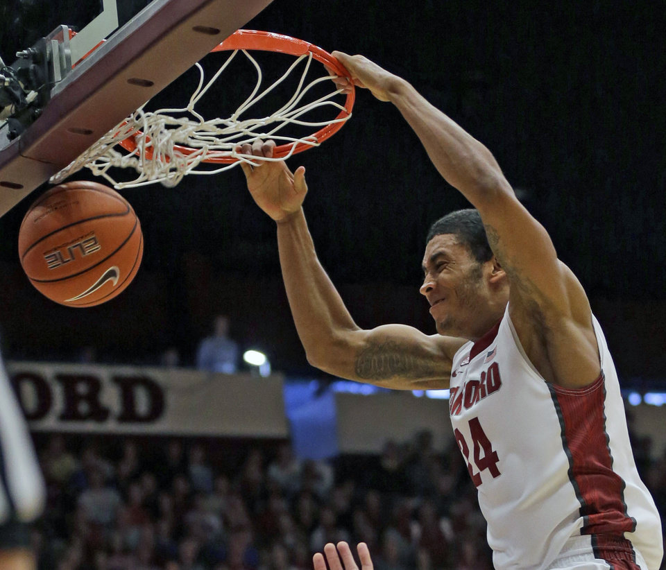 Photo - Stanford forward Josh Huestis dunks against UCLA during the second half of an NCAA college basketball game on Saturday, Feb. 22, 2014, in Stanford, Calif. Stanford won 83-74. (AP Photo/Marcio Jose Sanchez)