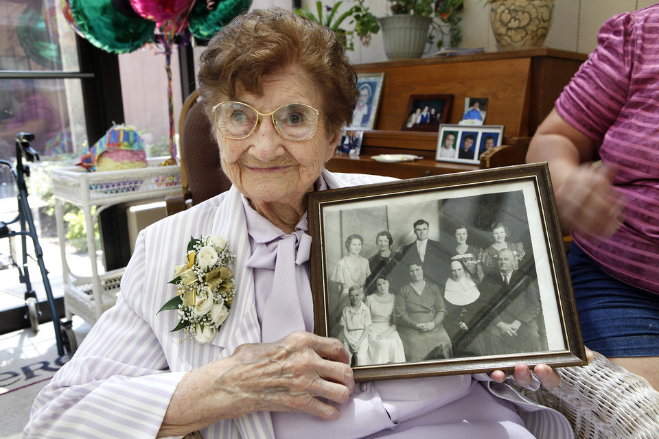 Sister Mary Clotilda Toelle  celebrates her 100 birthday at The Mercy Convent next to Mercy Hospital, Wednesday, June 27, 2012. Toelle is holding a photo of her with her family, she is the one in the habit. Photo By David McDaniel/The Oklahoman