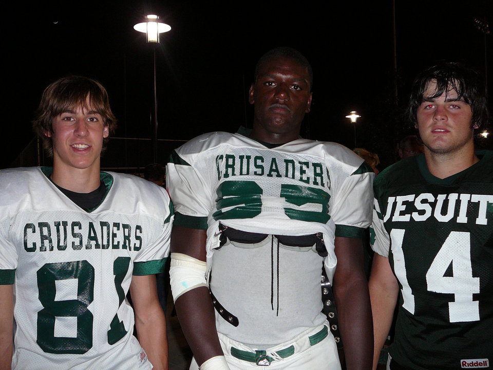 Photo - Right: David King, center, with Strake Jesuit teammates Kyle Knizner, left, and Jeff McVaney.  PHOTOs PROVIDED