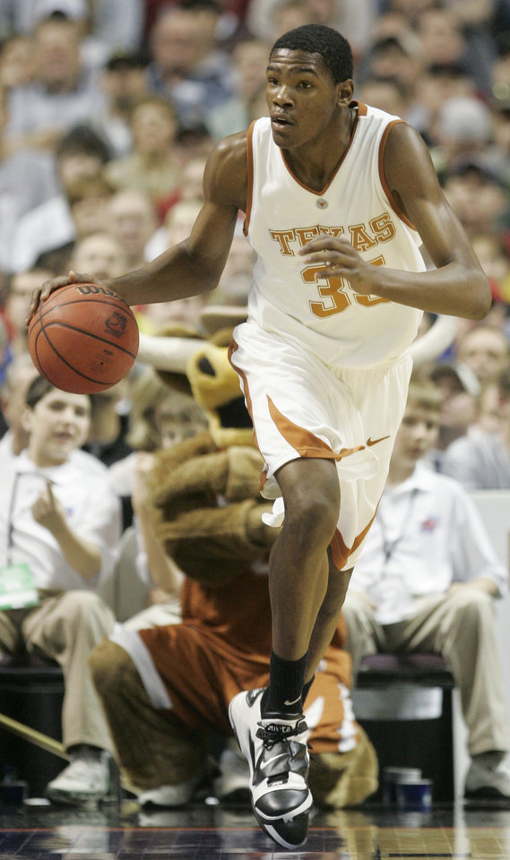 Photo - Texas forward Kevin Durant moves downcourt in the first half against Southern California Sunday, March 18, 2007, at Spokane Arena in Spokane, Wash., in an NCAA East Regional second-round basketball game. (AP Photo/Rick Bowmer) ORG XMIT: WARB202