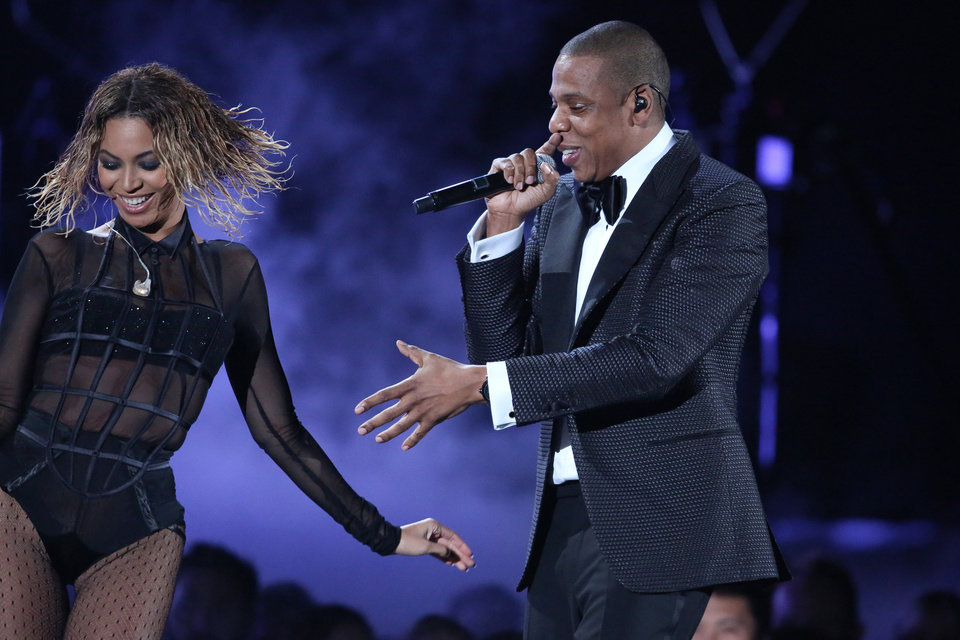 Photo - Beyonce, left, and Jay-Z perform