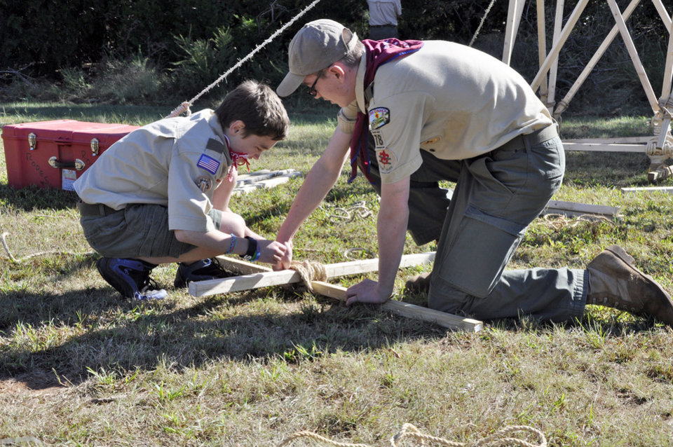 Jacob Rogers, 12, and Jason Chandler, 15, both of Edmond, tie two boards together during a Webelos campout over the weekend in Oklahoma City. Photo by M. Tim Blake, for The Oklahoman