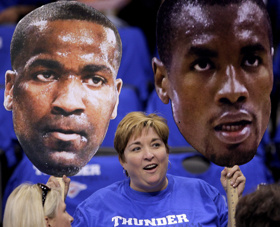 Photo - Brenda Granger of Oklahloma City holds cardboard cutouts of Kendrick Perkins and Serge Ibaka before game two of the Western Conference semifinals between the Memphis Grizzlies and the Oklahoma City Thunder in the NBA basketball playoffs at Oklahoma City Arena in Oklahoma City, Tuesday, May 3, 2011. Photo by Bryan Terry, The Oklahoman