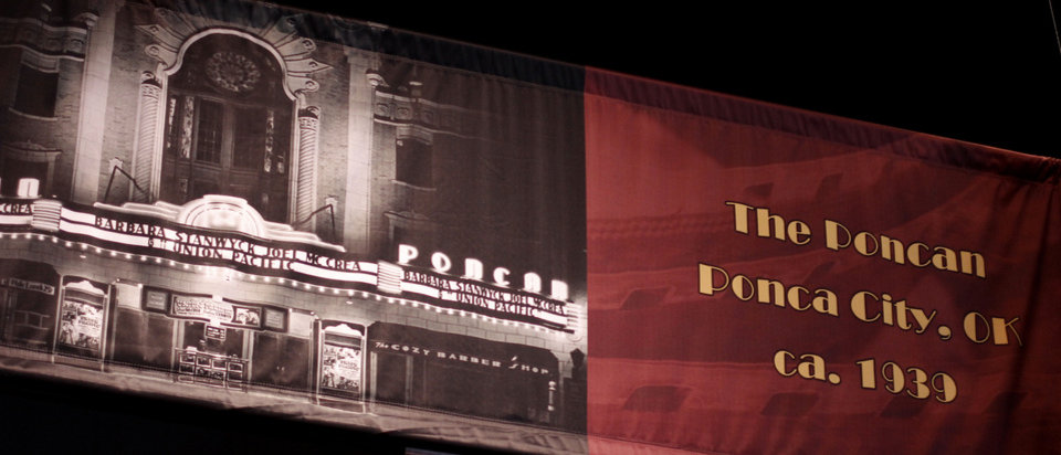 Photo - A photo of the historic Poncan Theatre in Ponca City is displayed in the Oklahoma @ the Movies exhibit. Photo by Doug Hoke, The Oklahoman  DOUG HOKE