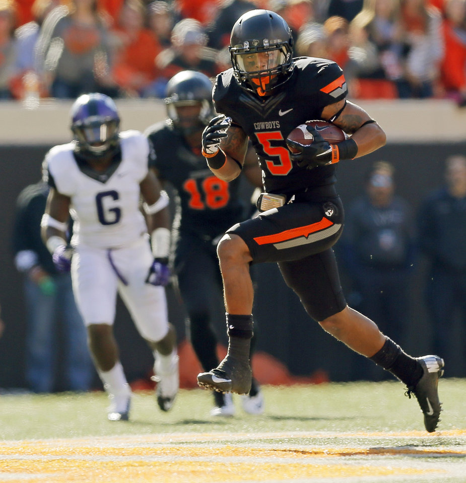 Photo - Oklahoma State's Josh Stewart (5) runs after a catch in the second quarter during a college football game between Oklahoma State University (OSU) and Texas Christian University (TCU) at Boone Pickens Stadium in Stillwater, Okla., Saturday, Oct. 27, 2012. Photo by Nate Billings, The Oklahoman