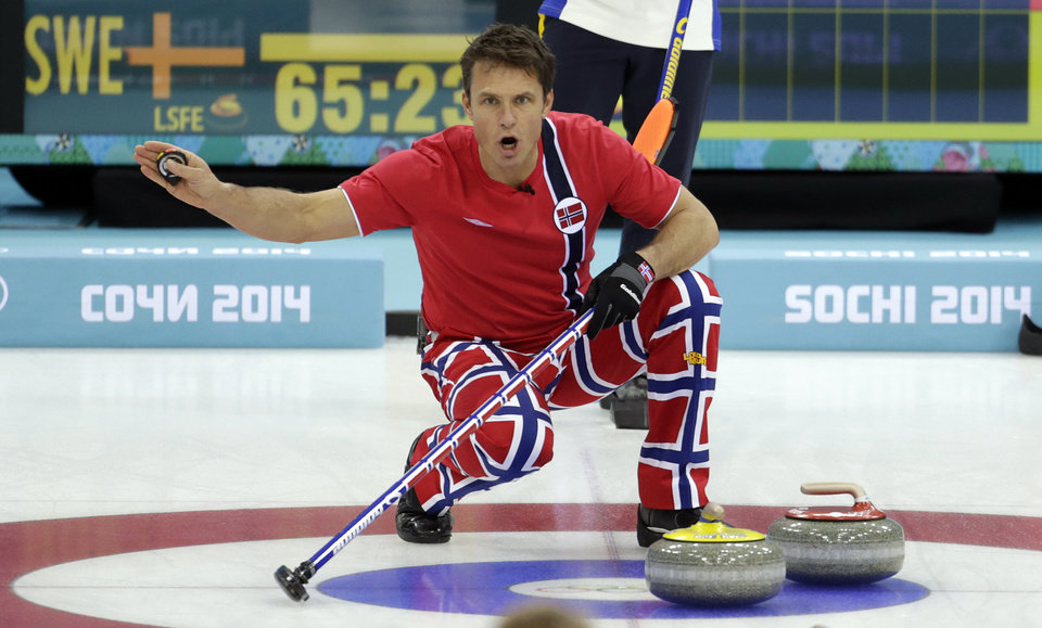 Photo - Norway's skip Thomas Ulsrud shouts instructions from the house during men's curling competition against Sweden at the 2014 Winter Olympics, Thursday, Feb. 13, 2014, in Sochi, Russia. (AP Photo/Robert F. Bukaty)