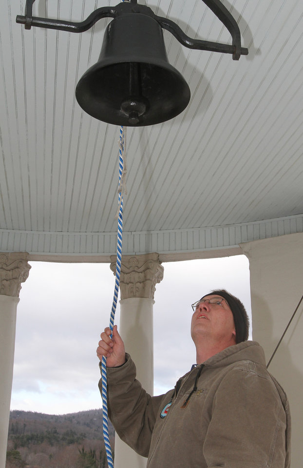 Mike Webb, with Henderson County Central Services, rings the Henderson County Historic Courthouse bell 26 times at 9:31 a.m. on Friday, Dec. 21, 2012 in Hendersonville, N.C., in honor on the victims at Sandy Hook Elementary. (AP Photo/The Times-News, Mike Dirks)