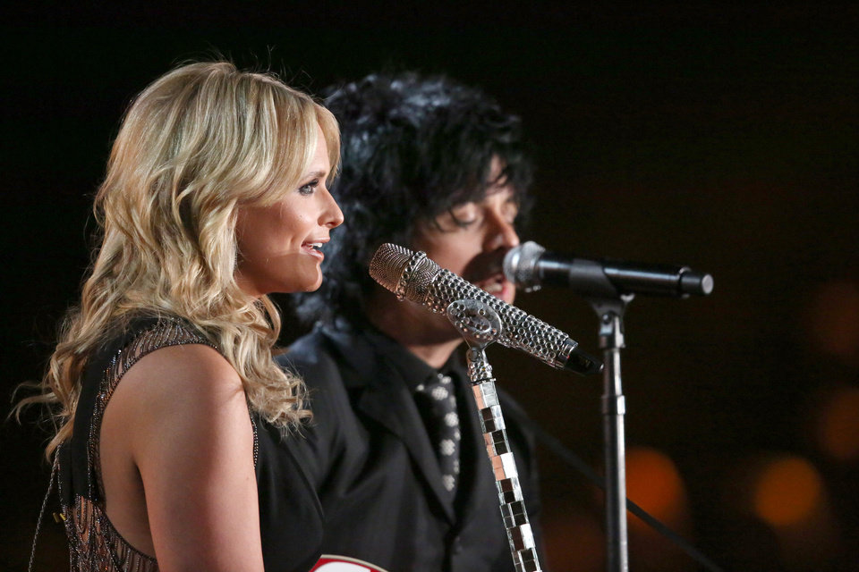 """Photo - Miranda Lambert, left, and Billie Joe Armstrong perform """"When Will I be Loved"""" on stage at the 56th annual Grammy Awards at Staples Center on Sunday, Jan. 26, 2014, in Los Angeles. (Photo by Matt Sayles/Invision/AP)"""